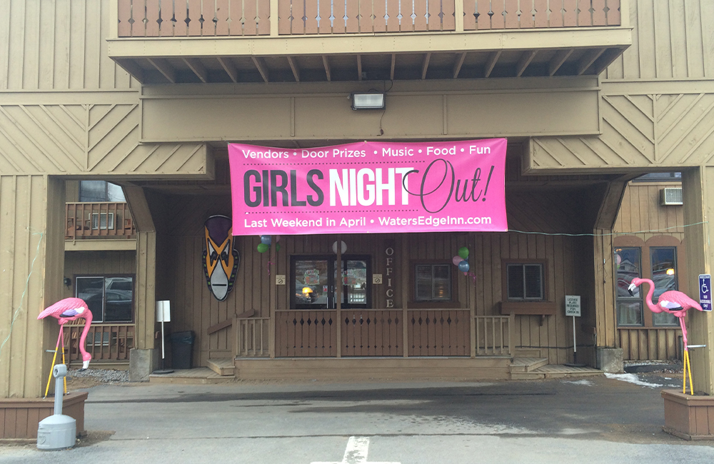 Big sign saying girls night out on the outside of a building