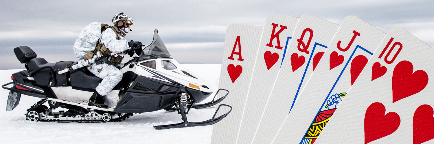 A snowmobiler on the left and a spread out hand of cards on the right