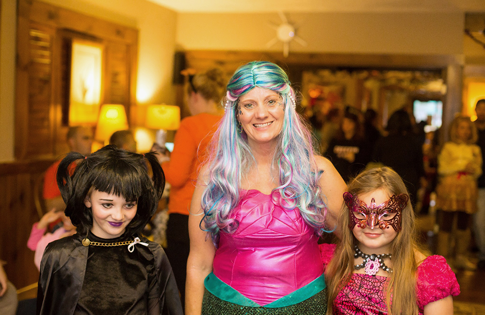 A mom and her girls dressed up for halloween