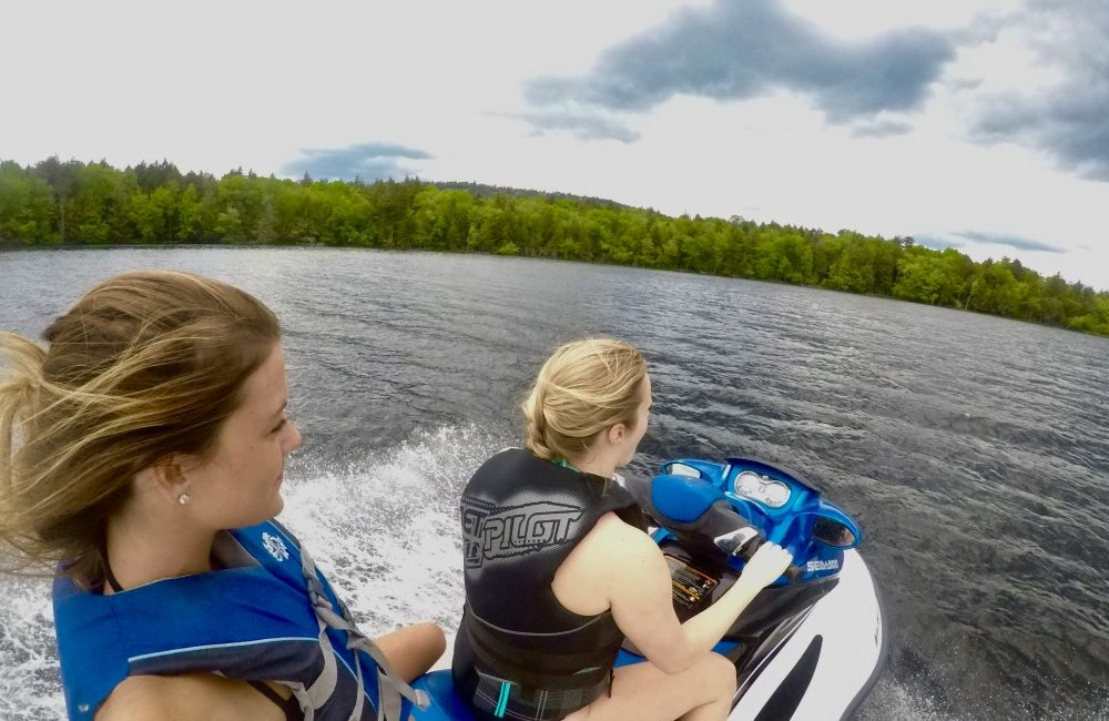 Two girls on a jet ski on the lake